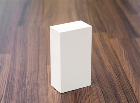 on table white box on wooden table photo free