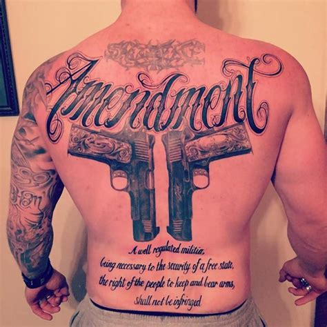 brantley gilbert shows off back tattoo supporting guns