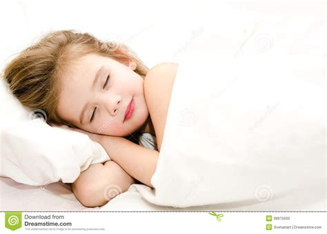 how to get her in bed little girl sleeping in her bed stock photo image 38975933