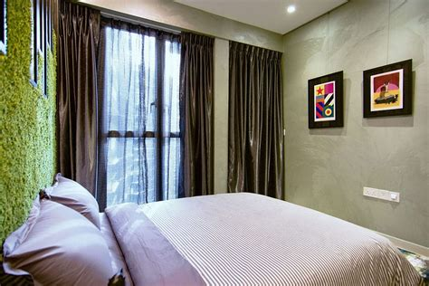 inside the bedroom silken drapes and walls with texture make a bold statement