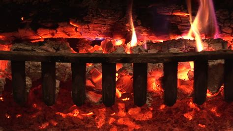 fireplace glowing embers seamless loop features burning logs in a cfire with
