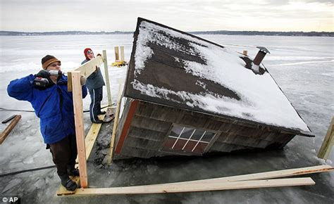 Shelter House Plans by Workers Suspend Themselves Over Thawing Lake Mendota To