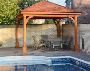 Backyard Creations Deluxe Arched Pergola With Gold Trim Cedar Gable Roof Open Rectangle Pavilions Pavilions