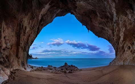 landscape nature beach cave sand rock sea clouds
