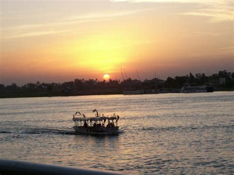 small boat nile cruises sunset on the nile and a small tour boat picture of nile