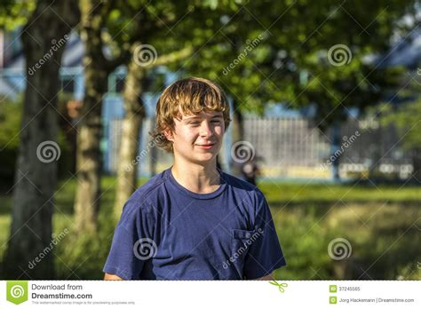 cute teen boy stock photos pictures royalty free cute portrait of a smiling teen boy in the open air royalty