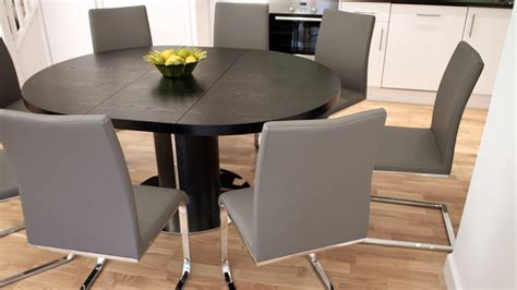 Modern Round Black Ash Extending Table And Chairs Black Black Ash Dining Table And Chairs