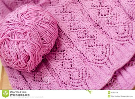 Handmade Woolen Design - pink detail of woven handicraft knitting sweater o royalty