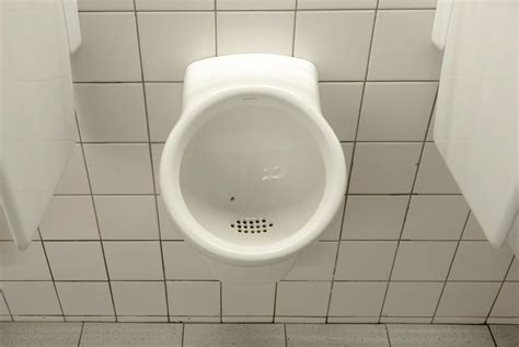 urinal bathroom aiming to reduce cleaning costs by blake evans pritchard