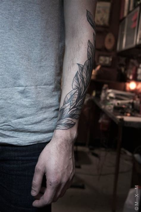 tattoo near arm tattoo of leaves twisting around the arms love love love