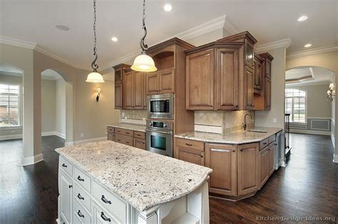 Brown Kitchen Cabinets With White Appliances