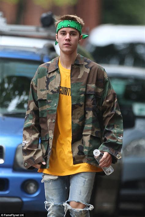 along with the gods london justin bieber dons military jacket during purpose tour in
