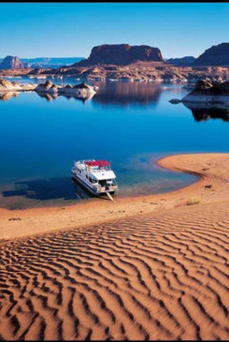 house boat grand canyon lake powell colorado river straddling the border between