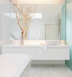 Touch to a crisp bathroom white floating vanity and frameless mirror