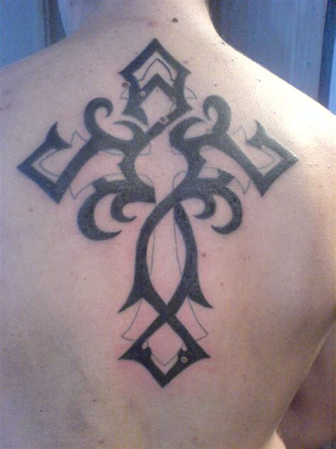 cross tribal tattoo tribal cross black ink on back