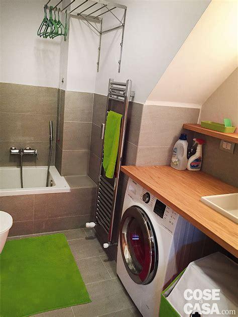 nel bagno cucina a vista sul soggiorno nel sottotetto con terrazzi a