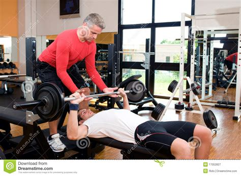 bench press assistance bench press at gym stock image image of health people
