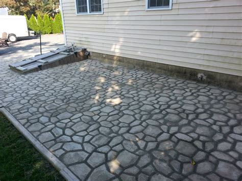 Concrete Patio Forms by Diy Concrete Cobblestone Patio Diy Barrel Stove