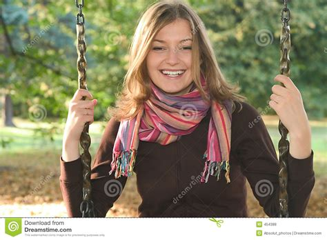 woman on a swing young woman on a swing royalty free stock photos image