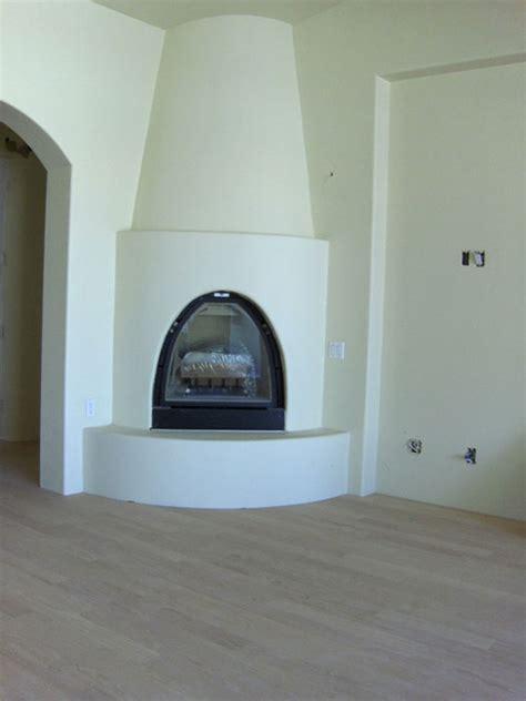 Kiva Gas Fireplace by Armijo Soledad Earth Builders