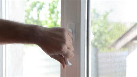 close window scratching away unnecessary parts around window preparing