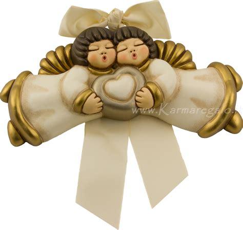 candele thun coppia angeli con cuore thun avorio