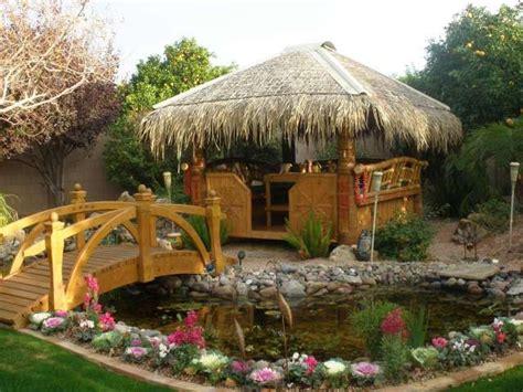 tiki hut garden tiki hut koi pond with bridge oυт σσя lινιиg