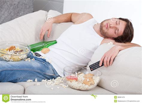 sleeping on the couch depression full and drunk man royalty free stock image image 36081476