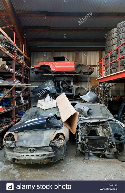 porsche mechanic berlin germany old porsche cars in the warehouse of a