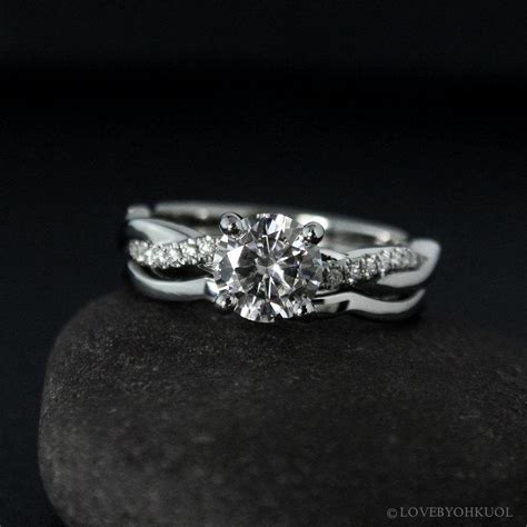 forever one moissanite engagement ring on twisted vine