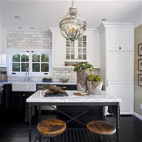 french kitchen island marble top white upper cabinets and black bottom cabinets with french