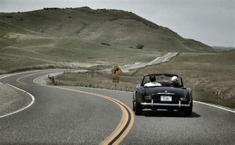 road drivers bmw 507 at speed on sutter butte road driving in 2012 california mille rally martyn