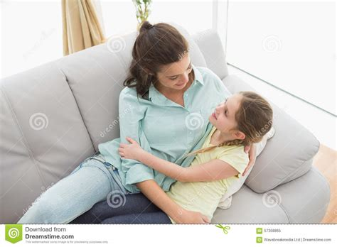 mom couch cute mother and daughter on the couch stock photo image