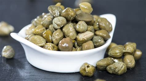 you cook with capers but do you know what they really are the splendid table