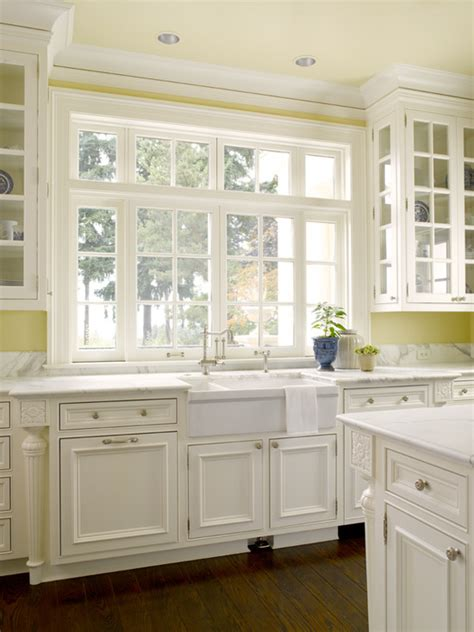 kitchen cabinets with windows pale yellow walls design ideas