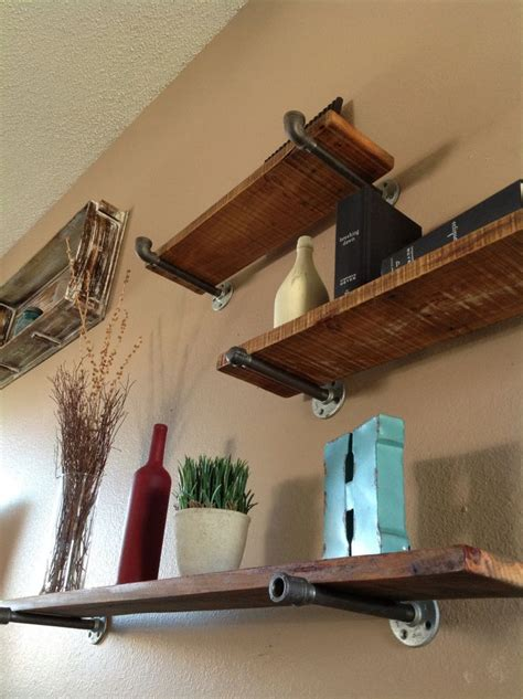 industrial floating shelves use cedar planks and