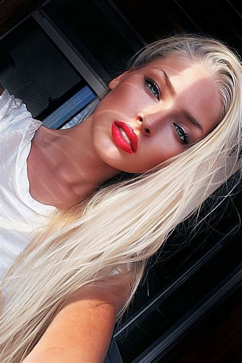blonde girl with red lipstick she looks like a blonde version of megan fox beauty