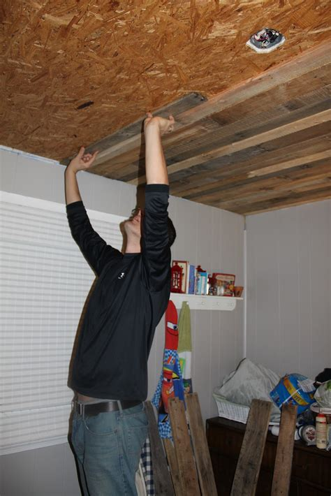 how to hang a l from the ceiling remodelaholic rustic pallet wood ceiling tutorial