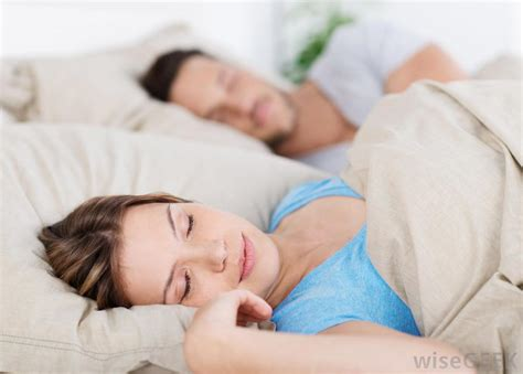 man sleeping in bed what is melatonin with pictures