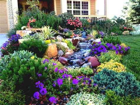 colorful modern front yard landscape garden with various flower beds and rocks artenzo