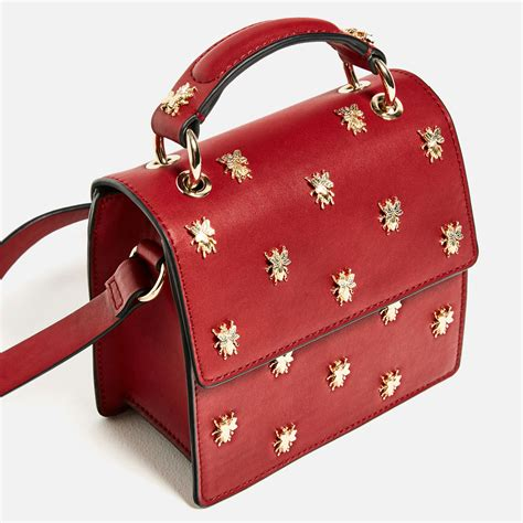 Think Metallic Bags Are Tacky Check Out The Betseyville 24k by The Handbag 5 Bags That Bring It Budget Fashionista