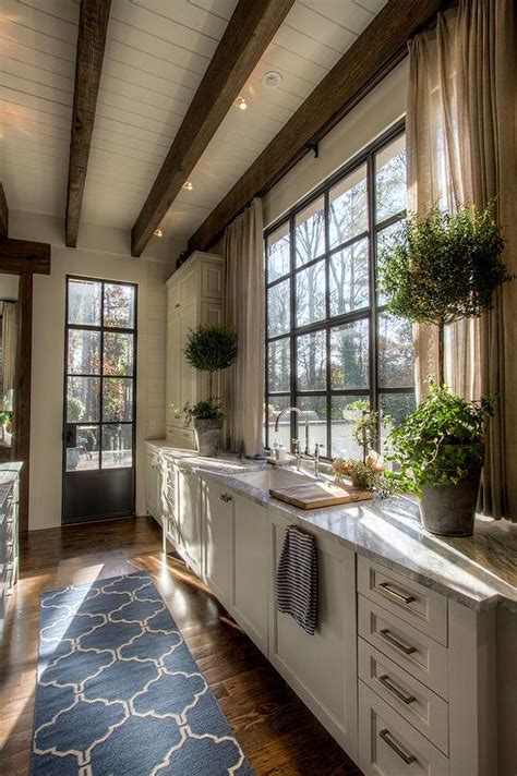 kitchen sink window  short curtains country kitchen