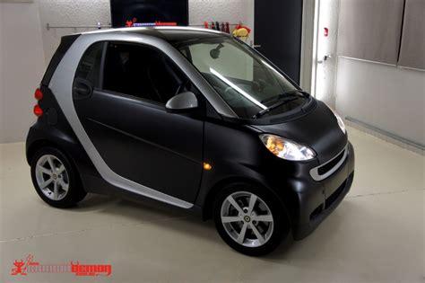 matte black smart fortwo car vinyl wrap by carbon demon
