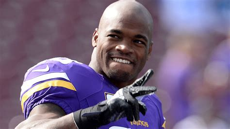 adrian peterson tattoo adrian peterson s tattoos make him look diesel