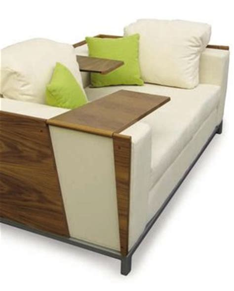 what a cool sofa with built in tv tables that fip up to