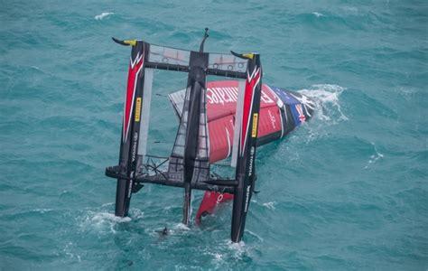 capsized cruising catamaran emirates team new zealand in dramatic capsize but ben
