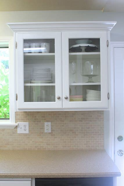 glass front kitchen cabinet door big kitchen makeover on a little budget the two i m