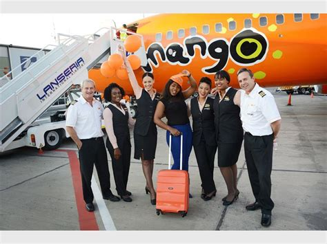 Mango Airlines Cabin Crew by Airline Celebrates 20 Millionth Guest At Lanseria
