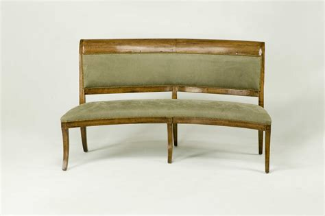 furniture grey upholstered bench with low back and nails