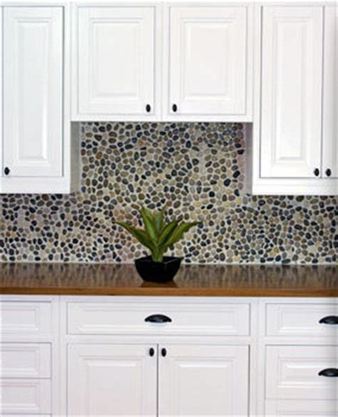 white inset cabinets with pebble backsplash traditional